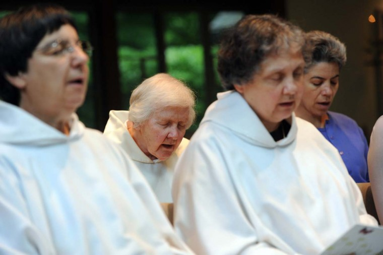 Sister Veronica Emmick (second from left) and other Carmelite nuns are shown during Vespers. (Kim Hairston/Baltimore Sun Photo)