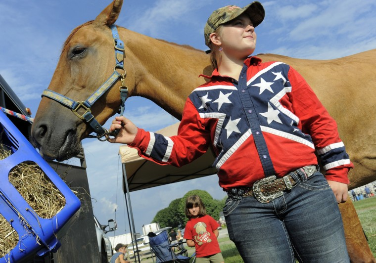 Amber Goff, of Westminster, Md., is a barrel racer. She is pictured with her horse, Daisy. (Lloyd Fox/Baltimore Sun)