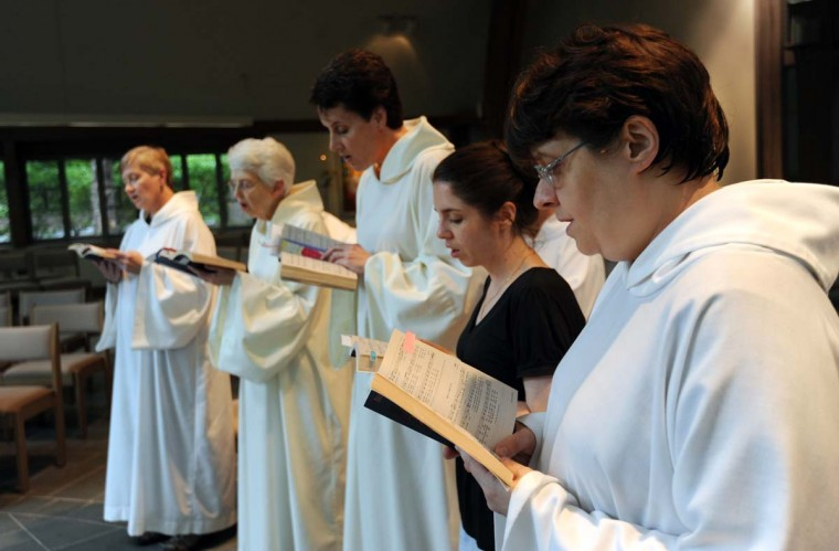 Today's Carmelite nuns wear white robes for services, regular clothes the rest of the time. Since 1990, they regularly worship in a light-filled chapel alongside members of the public, about 140 of whom come for Sunday services. (Kim Hairston/Baltimore Sun Photo)