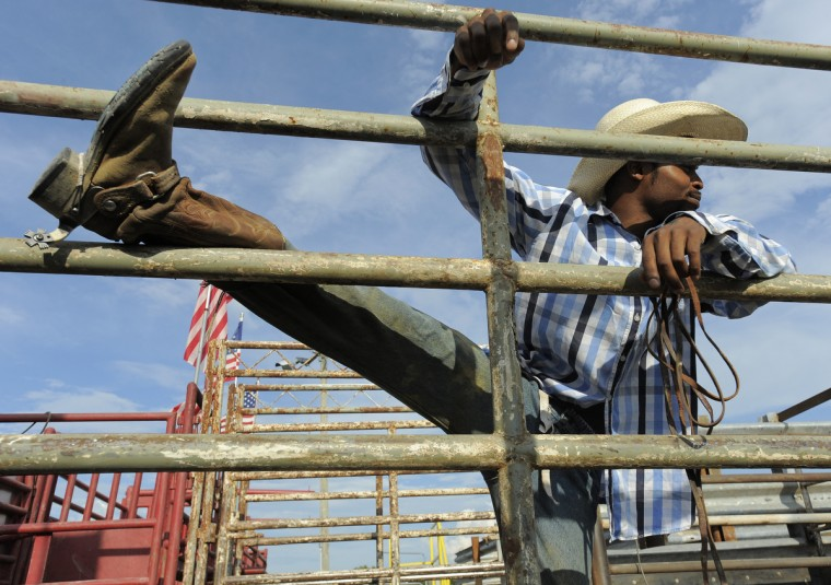 Cowboy Devon Weaver of Portage, Pa., stretches out prior to the bull riding competition. (Lloyd Fox/Baltimore Sun)
