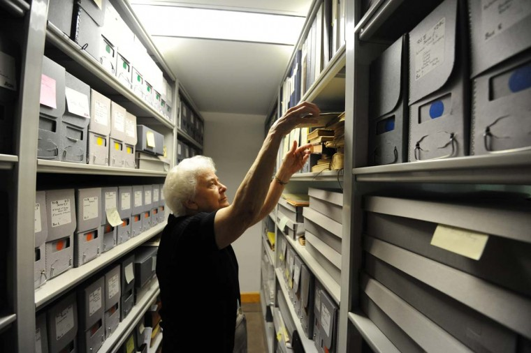 Sister Constance (Connie) FitzGerald pulls a document from the monastery archives. FitzGerald, 79, a historian and scholar, has lived at the monastery since 1951. (Kim Hairston/Baltimore Sun Photo)