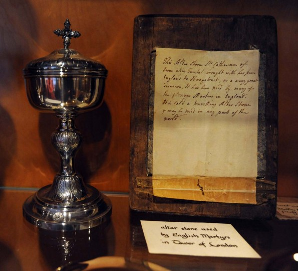 "In the Baltimore Carmel archives, a note next to an artifact (right) reads ""Altar stone used by English Martyrs in Tower of London."" (Kim Hairston/Baltimore Sun Photo)"