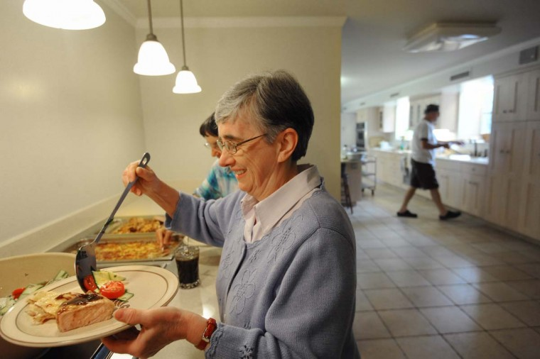 Sister Luisa Santa Cruz goes through the serving line during the midday meal at Baltimore Carmelite Monastery. (Kim Hairston/Baltimore Sun Photo)