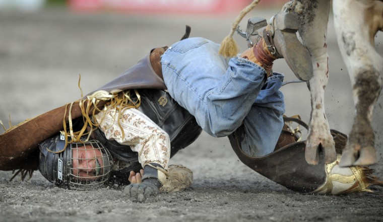 Cowboy Nick Proud of Union Bridge, Md., hits the ground after falling off the bull he was riding. (Lloyd Fox/Baltimore Sun)