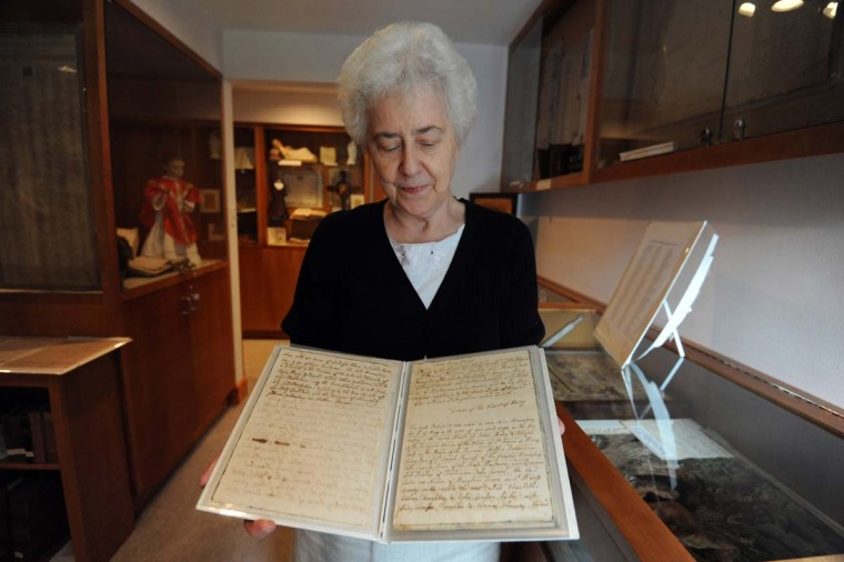 Sister Constance (Connie) FitzGerald looks at the Profession Book at Baltimore Carmel. (Kim Hairston/Baltimore Sun Photo)