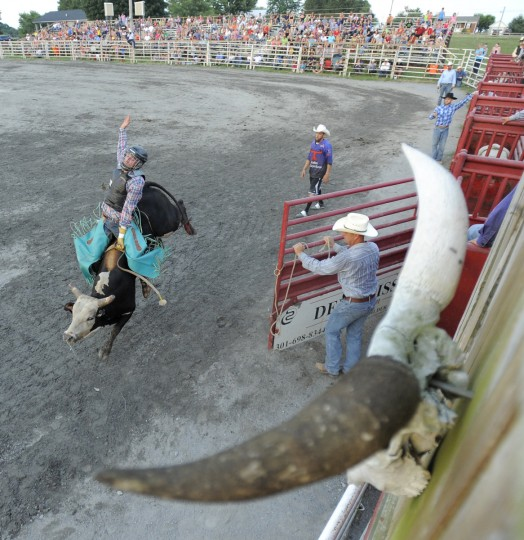 Cowboy Kyle Andrews rides his bull during the competition. (Lloyd Fox/Baltimore Sun)