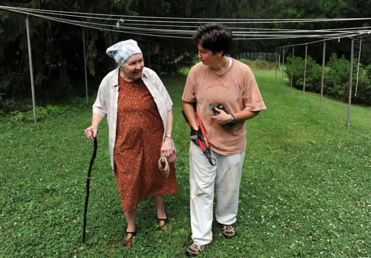Sister Veronica Emmick (left) and Cecilia Ashton, a postulant, walk the grounds. One of 65 Carmelite monasteries in the nation, Baltimore Carmel houses 18 nuns and two postulants (community members-in-training), women ranging in age from 33 to 93. Their ex-professions include dentistry, nursing, education and the law. (Kim Hairston/Baltimore Sun Photo)