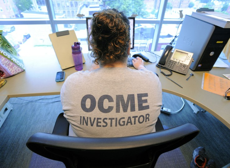 Forensic investigator Melinda Fitzgerald fields calls about any deaths in the state of Maryland. About 80 full-time employees, many of them pathologists, work at the Office of the Chief Medical Examiner in Baltimore. (Lloyd Fox / Baltimore Sun Photo)