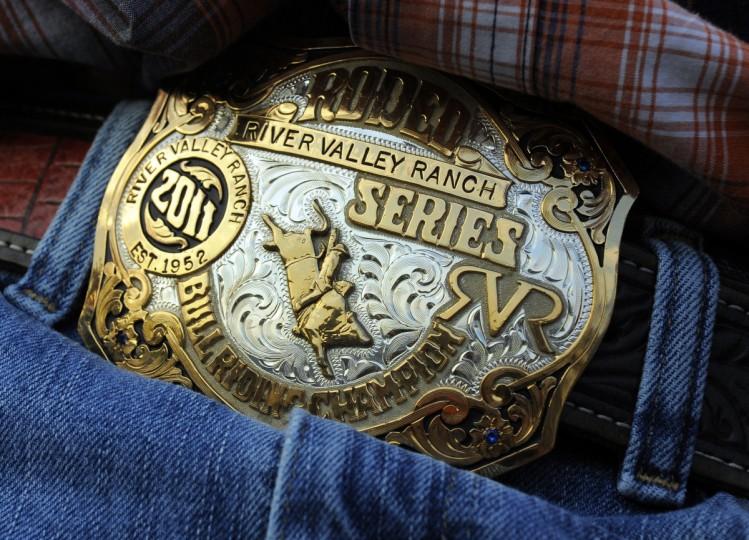 A cowboy wears a trophy belt buckle. (Lloyd Fox/Baltimore Sun)