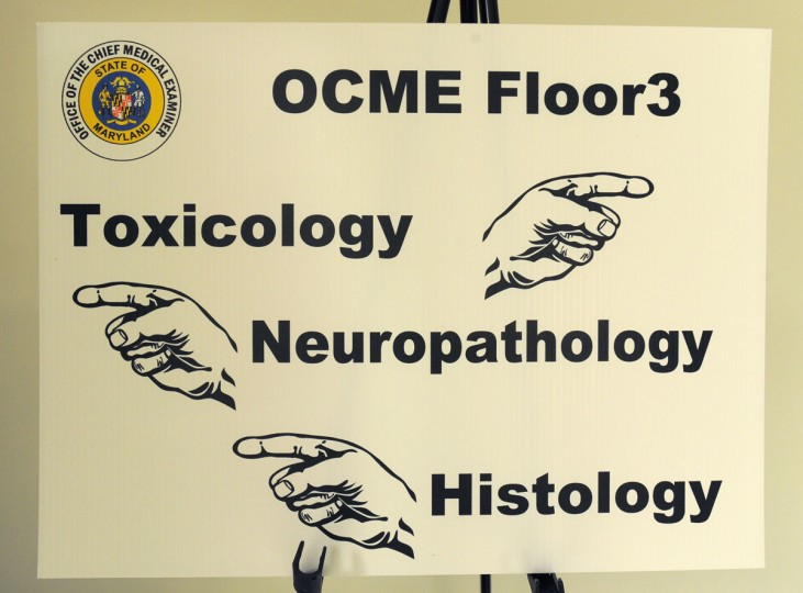 A sign directs staff and visitors to the labs on the third floor of the Office of the Chief Medical Examiner in West Baltimore. (Lloyd Fox / Baltimore Sun Photo)