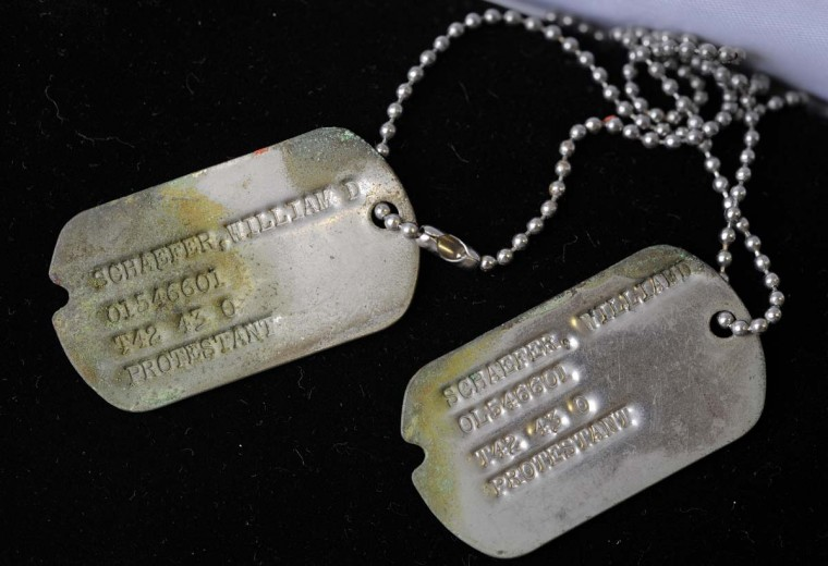 William Donald Schaefer's military tags are part of the collection. Schaefer was a hospital administrator in England during World War II. The facility tended to the thousands of wounded servicemen returning from the front lines. (Lloyd Fox/Baltimore Sun)