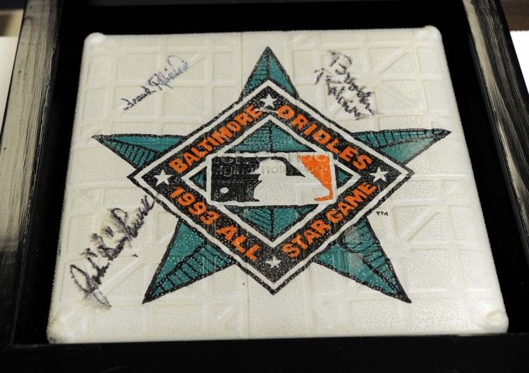 William Donald Schaefer kept a base from the 1993 baseball All-Star Game played in Baltimore and signed by Brooks Robinson, Frank Robinson and Boog Powell. (Lloyd Fox/Baltimore Sun)