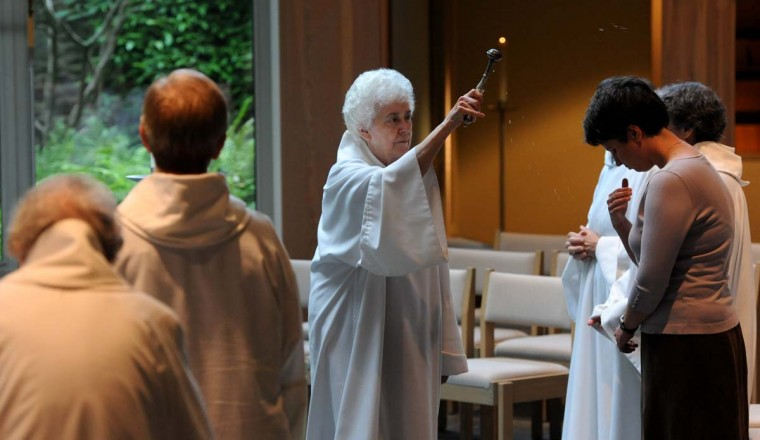 "Sister Constance (Connie) FitzGerald, sprinkles holy water on Cecilia Ashton, a postulant, during the last part of Vespers in the chapel. ""There's a connection between prayer and people's lives,"" Sr. Connie says. ""We believe that. If we didn't, we wouldn't be here."" (Kim Hairston/Baltimore Sun Photo)"