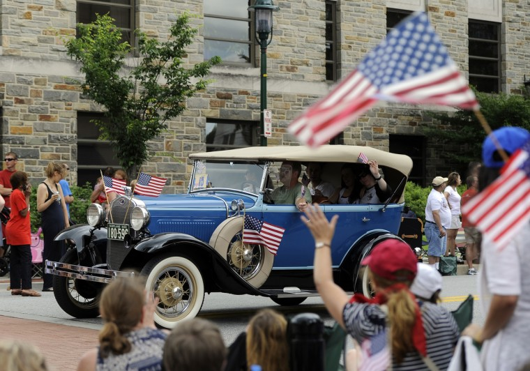 An antique car drives in the Towson Fourth of July parade. (Barbara Haddock Taylor/Baltimore Sun)