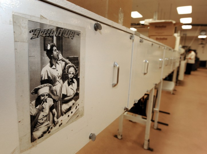"A photo of the infamous candy-making scene from the sitcom ""I Love Lucy"" is tacked onto a cabinet in the middle of the production facility. (Algerina Perna/Baltimore Sun)"