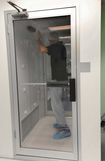 Before entering the clean room, employees and contractors must pass through several cleaning steps, including this air shower to remove particles. (Algerina Perna/Baltimore Sun)