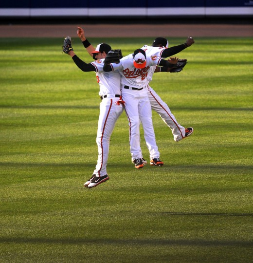 Orioles Ryan Flaherty, Nick Markakis and Adam Jones celebrate in the outfield after the Orioles' 6-5 win over Texas at Oriole Park at Camden Yards on May 10, 2012. (Gene Sweeney, Jr./Baltimore Sun)