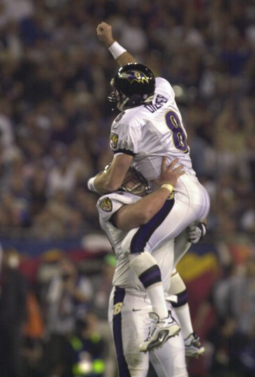 Ravens quarterback, Trent Dilfer jumps into the arms of Scott Mitchell (center) to celebrate a touchdown pass to Brandon Stokley during Super Bowl XXXV in Tampa, January 28, 2011. The Ravens won the game 34-7. (Gene Sweeney Jr./Baltimore Sun)