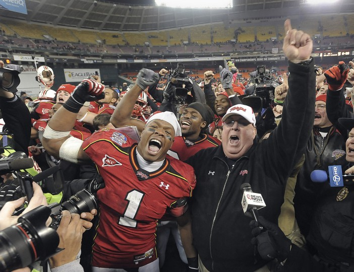 Washington, DC -- 12/29/10 -- Maryland Terrapins vs. East Carolina in the Military Bowl at RFK Stadium. Maryland linebacker Adrian Moten and head coach Ralph Friedgen celebrate winning the Military Bowl against East Carolina at RFK Stadium in Washington, D.C., on Dec. 29, 2010. (Gene Sweeney Jr./Baltimore Sun)