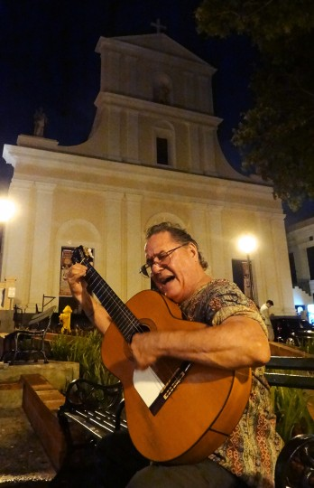A street performer plays his guitar and sings for tips outside the Cathedral of San Juan Bautista. The church is the second-oldest building in San Juan. (Robert K. Hamilton/Baltimore Sun)