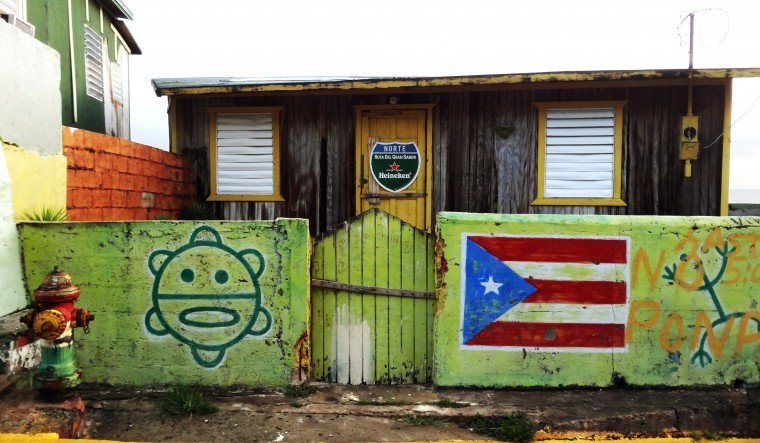 A shack painted with a Puerto Rican flag located on Calle Lucia Silva (Lucia Silva Street) in La Perla, a historic community located adjacent to the north wall of the city. The neighborhood faces the Atlantic coast and is situated east of the famous Santa Mari'a Magdalena de Pazzis Cemetery. (Robert K. Hamilton/Baltimore Sun)