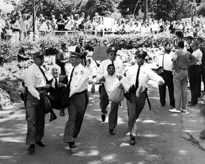 July 1963: Baltimore County policemen carry an anti-segregation demonstrator from Gwynn Oak Park. Protestors numbered in the hundreds. (Walter McCardell/Baltimore Sun)