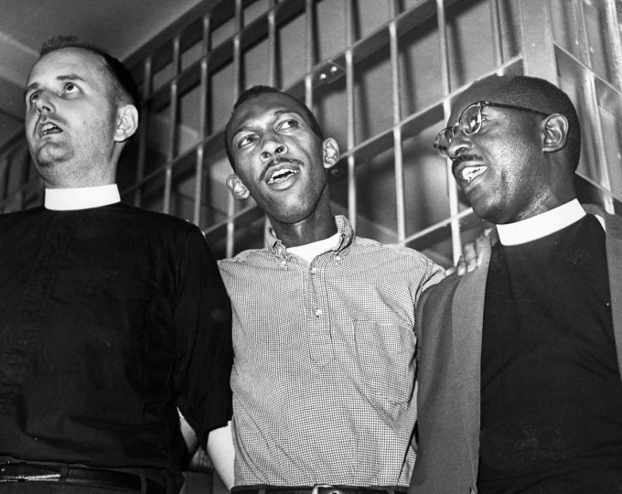 "July 1963: Singing ""I Woke Up This Morning With My Mind On Freedom"" after a night in the Baltimore County Jail is (LtoR) Rev. William Dwyer, Episcopal minister from NY; Edward Chance, Baltimore C.O.R.E. chairman, and Rev. Frank Williams, local Methodist minister, who were arrested at Gwynn Oak Park after a demonstration. (Baltimore Sun photo)"