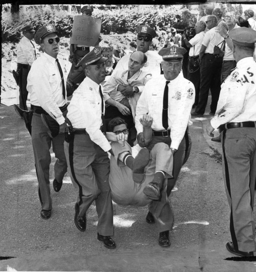 July 1963: Police carry out demonstrators at Gwynn Oak Park. The park was intergrated in August 1963. (Baltimore Sun photo)