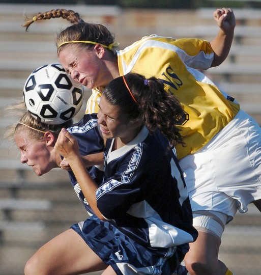 Severna Park's Lauren Stafford, top, battles for the ball with South River's Kasey Honeycutt, left, and Aly Shelly during this Sept. 15, 2005 game. (Gene Sweeney, Jr./Baltimore Sun)