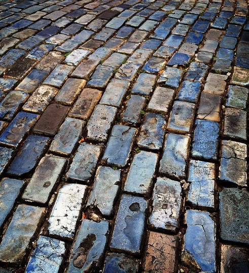 A view of the the blue cobblestones that make up the majority of the streets in Old San Juan. Some of these cobblestones have been in place for 500 years and are still in use. The cobblestones are not really a stone but rather the slag of iron smelting that arrived as ballast on ships traveling from Spain. (Robert K. Hamilton/Baltimore Sun)
