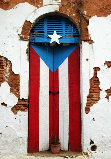 A doorway in Old San Juan located near the intersection of Calle Sol (Sun Street) and Calle Cruz (Cross Street) is decorated in the colors of the Puerto Rican flag. (Robert K. Hamilton/Baltimore Sun)