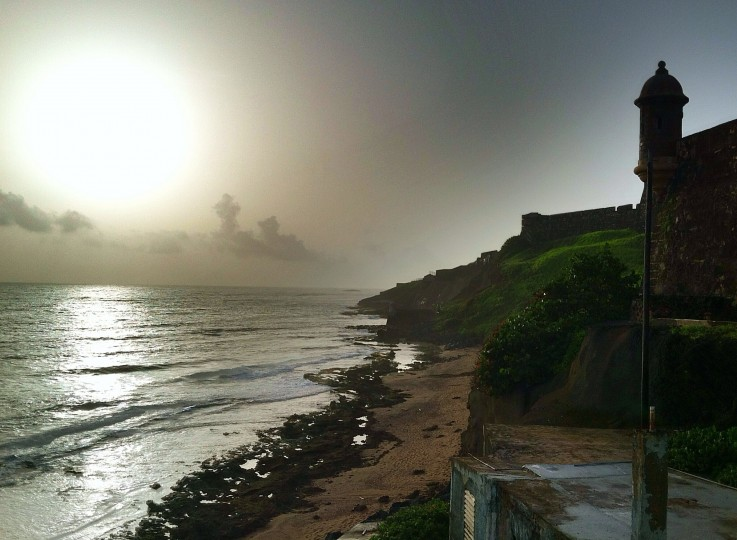 The Atlantic Ocean laps the shore near the north wall that runs from Fort San Felipe del Morro next to La Perla. La Perla is a historic neighborhood located next to the old walls of Old San Juan. (Robert K. Hamilton/Baltimore Sun)