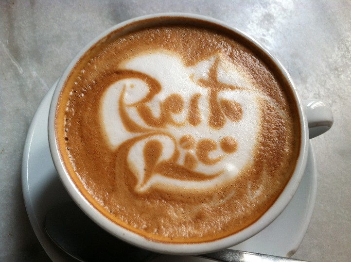 "A barista at the Caficultura restaurant demonstrates his artistic skills as he spells out ""Puerto Rico"" in the foam of a cup of cafeŽ con leche, coffee with steamed milk. (Robert K. Hamilton/Baltimore Sun)"