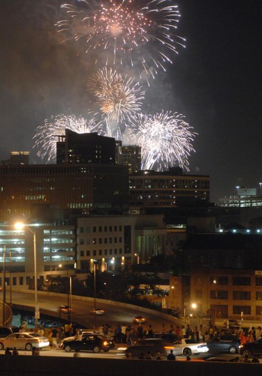 Spectators watch the 4th of July fireworks from the Orleans Street bridge in Baltimore. (Jerry Jackson/Baltimore Sun)