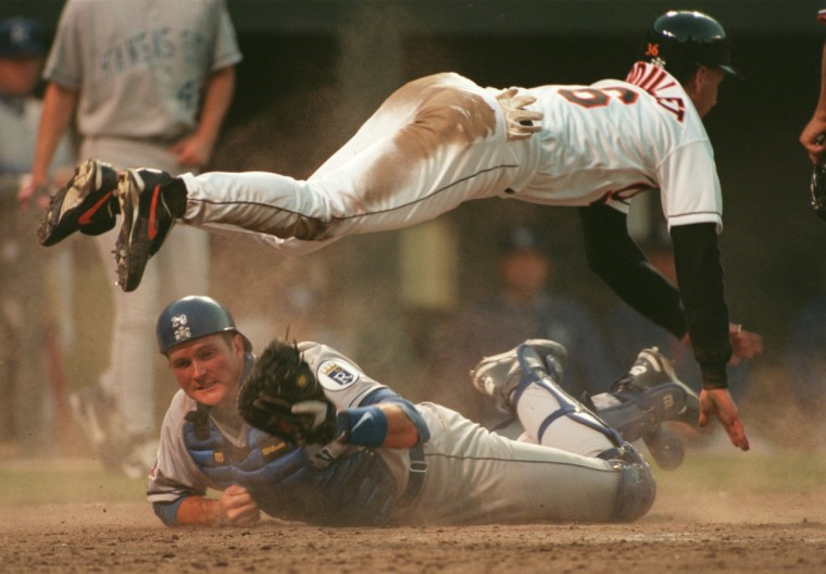 Kansas City Royals catcher Mike Sweeney, bottom, tagged out the Orioles' Jeff Reboulet to end the seventh inning in this April 2, 1997 game. (Gene Sweeney Jr. /The Baltimore Sun)