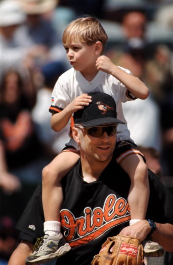 Cal Ripken Jr. walked around the field during spring training in 1999 with his son, Ryan, on his shoulders. (Gene Sweeney, Jr./Baltimore Sun)