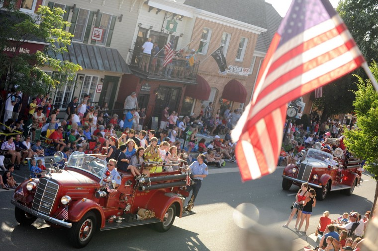 Historic fire engines with the Bel Air VFC roll up Main Street filled with young riders during the 4th of July Parade in Bel Air. (Brian Krista/Baltimore Sun Media Group)