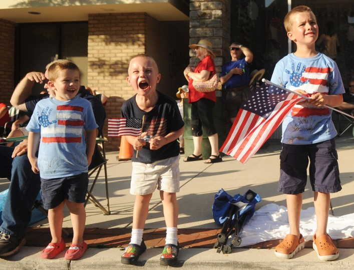 Three-year-old Kyle Petz of Havre de Grace screams with excitement as he watches the 4th of July Parade in Bel Air with his cousins Graham Nizer, 3, and Bradley Nizer, 6, of Bel Air. (Brian Krista/Baltimore Sun Media Group)