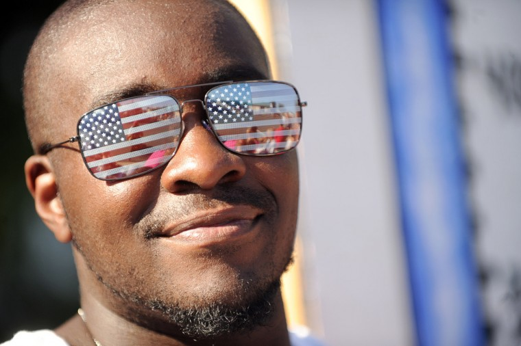 Keith Tilghman of Bel Air sports some patriotic shades while waiting for the start of the 4th of July Parade in Bel Air, Md. (Brian Krista/Baltimore Sun Media Group)