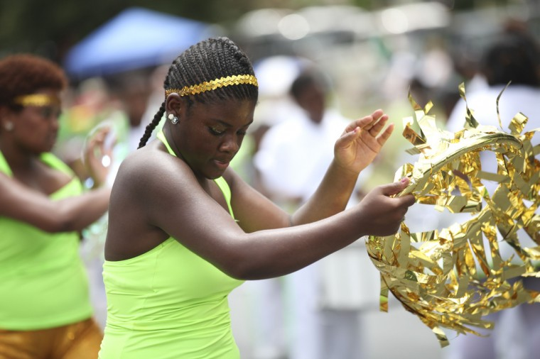 Ahyana Sewell, 13, dances through the Arbutus 4th of July Parade with the Dynasty Marching Unit of Baltimore. (Monica Herndon/Baltimore Sun Media Group)
