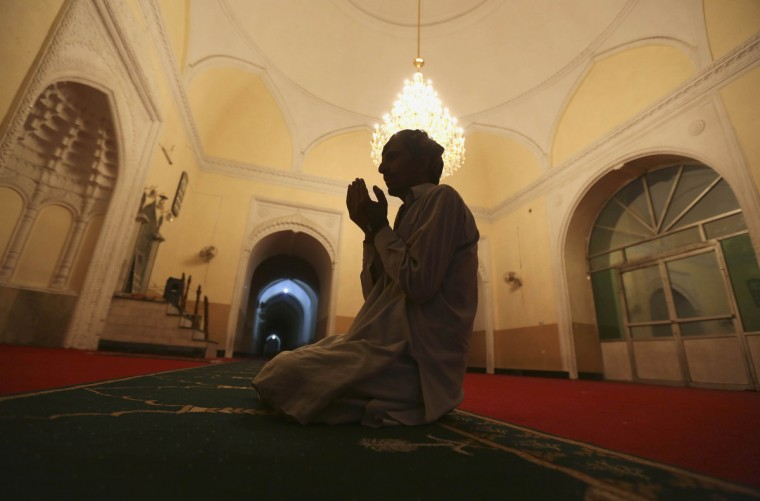 An Afghan man prays after breaking his fast on the first day of Ramadan, the holiest month in the Islamic calendar, at a mosque in Kabul July 10, 2013. (Omar Sobhani/Reuters)