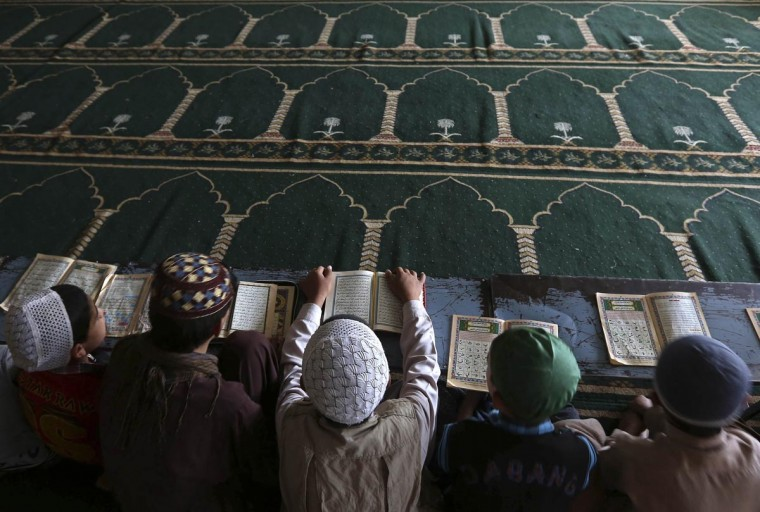 Boys read the Koran in a madrasa, or religious school, during the Muslim holy month of Ramadan in Kabul July 15, 2013. (Omar Sobhani/Reuters)
