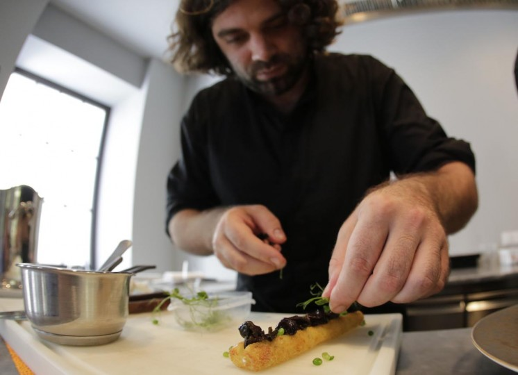 Austrian chef Konstantin Filippou prepares a snail dish in his gourmet restaurant in Vienna July 12, 2013. Andreas Gugumuck owns Vienna's largest snail farm, exporting snails, snail caviar and snail liver all over the world. (Leonhard Foeger/Reuters)