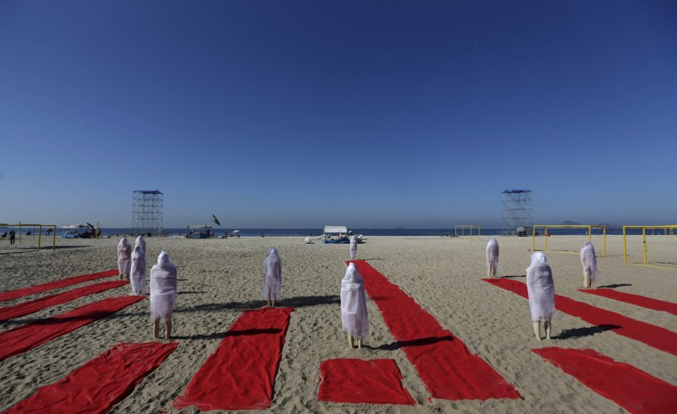 Mannequins representing missing people are placed in Copacabana Beach during a protest by non-governmental organization (NGO) Rio de Paz (Rio of Peace) in Rio de Janeiro. According to the organizers, 35,000 victims of violence are missing in the Rio de Janeiro state since 2007. (Ricardo Moraes/Reuters)