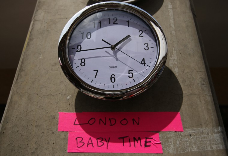 A clock in the press pen shows the time outside the Lindo Wing of St Mary's Hospital, where Britain's Catherine, Duchess of Cambridge is due to give birth, in London. (Olivia Harris/Reuters photo)
