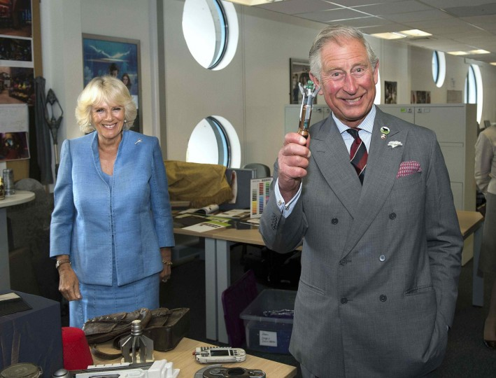Britain's Prince Charles holds a Sonic Screwdriver as he visits the set of the BBC One drama series Doctor Who, with his wife Camilla, Duchess of Cornwall, at Roath Lock Studios in Cardiff. (Arthur Edwards/Reuters)