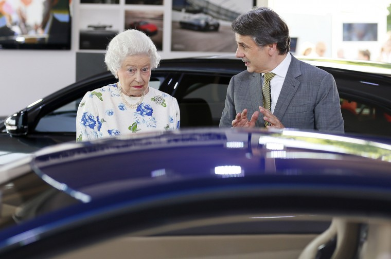 Britain's Queen Elizabeth looks at a Jaguar motor car at the Coronation Festival in the garden of Buckingham Palace, in central London July 11, 2013. Leading British companies will be showcased during the four-day Coronation Festival, celebrating the 60th anniversary of Queen Elizabeth's coronation. On Wednesday evening the Coronation Festival Gala will celebrate 60 years of music and dance in the gardens of the palace. (Stefan Wermuth/Reuters)
