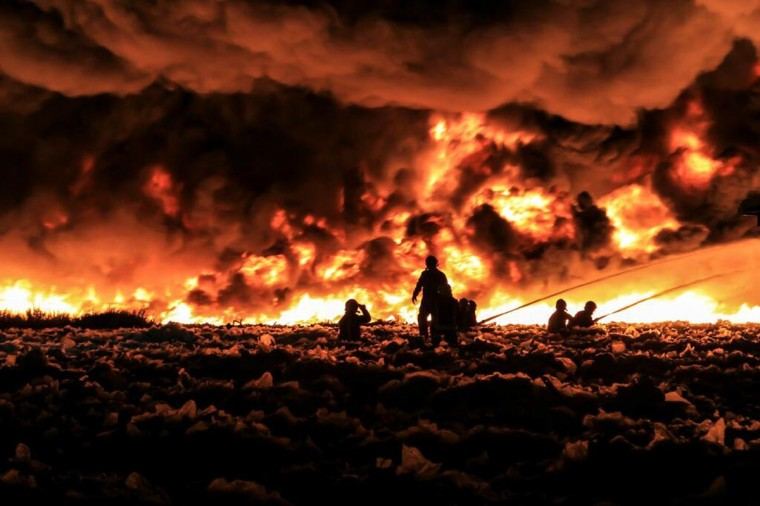 Fire fighters tackle a large blaze at a recycling centre in Smethwick, near Birmingham, central England July 1, 2013. Up to 200 firefighters and 40 fire engines were deployed. (West Midlands Fire Service Handout via Reuters)