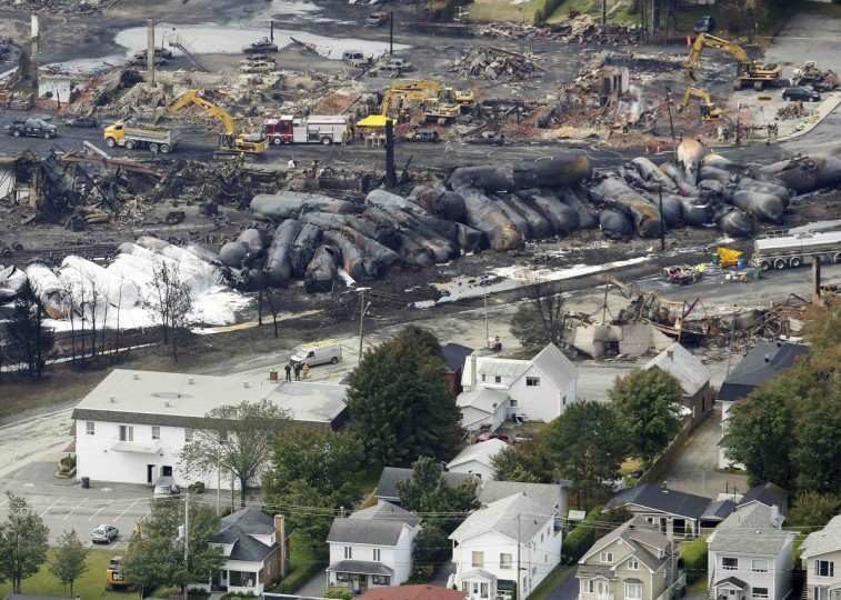 Workers and firefighters work on the remains of downtown Lac Megantic, July 8, 2013. (Mathieu Belanger/Reuters)