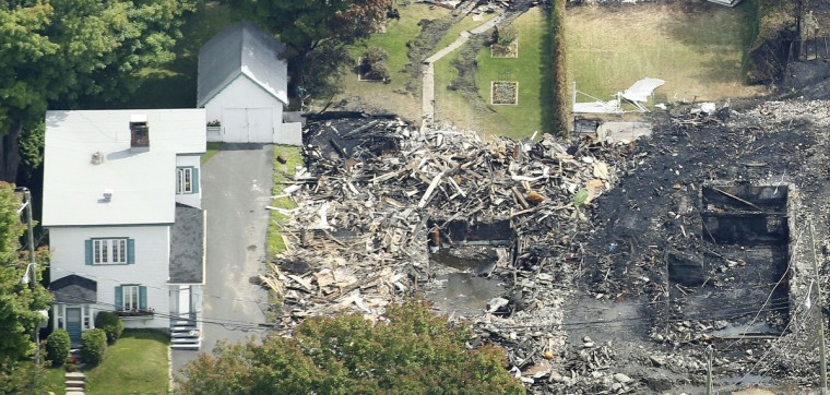 The remains of a house are seen after a train explosion in Lac Megantic, July 8, 2013. (Mathieu Belanger/Reuters)